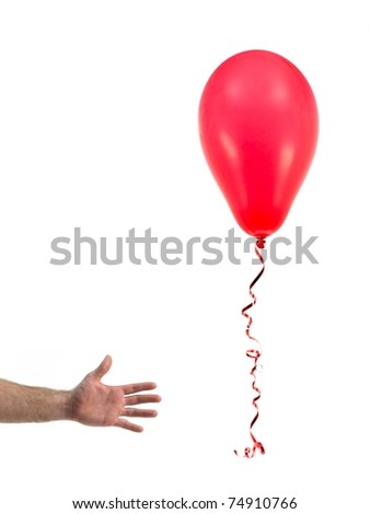 A red balloon isolated against a white background - stock photo