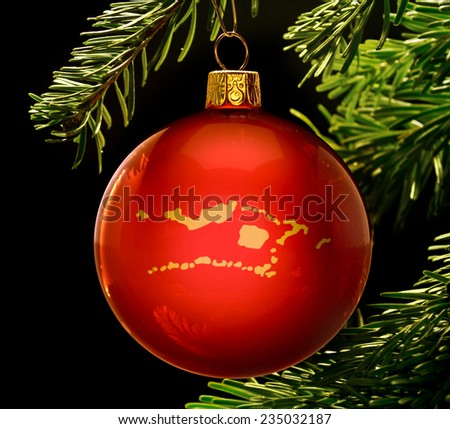 A red bauble with the golden shape of  Palmyra Atoll hanging on a christmas tree isolated on black.(series) - stock photo