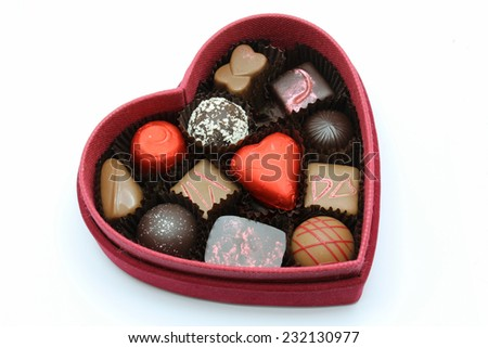 A red box of valentine chocolate for someone special. - stock photo