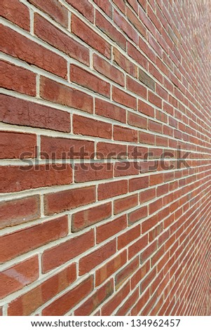 A red brick wall shot close with a wide angle lens for a super deep diminishing perspective. - stock photo