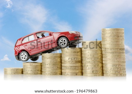 a red car climbing up a money chart isolated on a white background - stock photo
