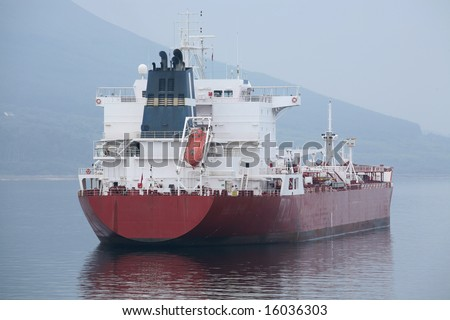 A red cargo tanker seen from the stern - stock photo