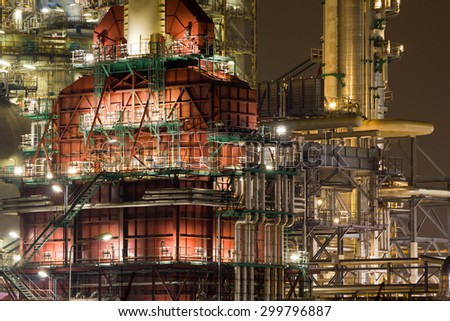 A red coker unit of an oil-refinery plant at night - stock photo