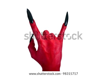 a red devil hand with black nails - stock photo