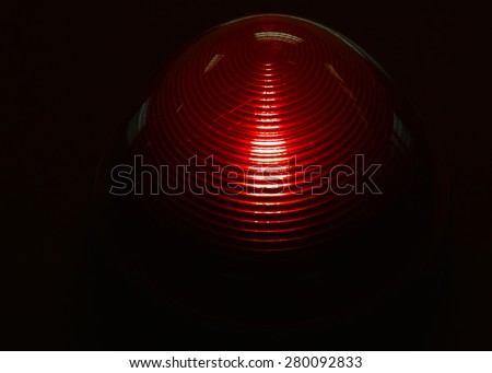 A red emergency light with reflections in the glass. - stock photo