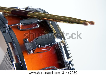 A red fade color snare drum with sticks isolated against a white background in the horizontal format. - stock photo