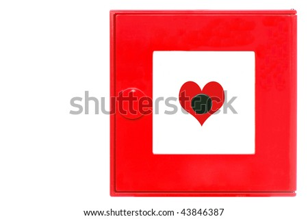 A red fire alarm box with heart. - stock photo