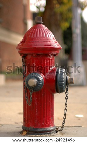 A red fire hydrant on a city street. - stock photo