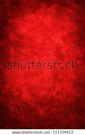 A red grunge paper background with a dark vignette.  Image displays a distinct grain texture at 100 percent. - stock photo