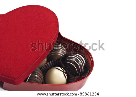 a Red heart shaped box of chocolates on a white background with space for text - stock photo