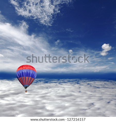 A red hot air balloon floating above the earth stratosphere. - stock photo