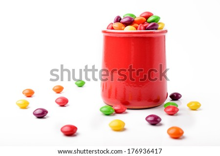 A red jar with rainbow candies - stock photo