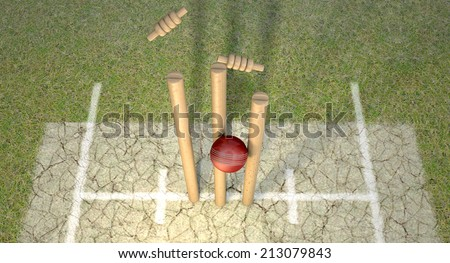 A red leather cricket ball hitting wooden cricket wickets on a grass cricket pitch background - stock photo