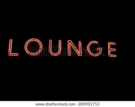 "A red neon sign that says ""Lounge"". - stock photo"
