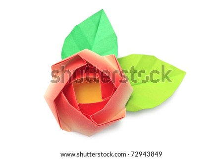 A red paper rose with two leaves on a white background - stock photo