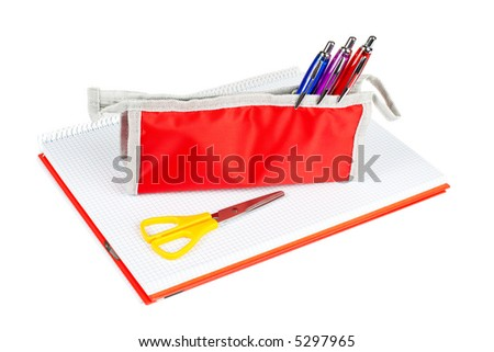 A red pencil case and yellow scissors over a notebook - stock photo