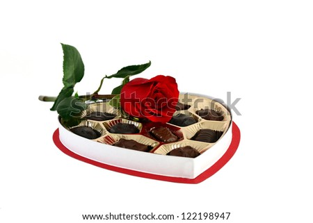 A red rose and a box of chocolates - stock photo