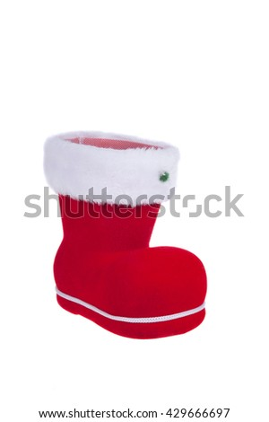 A red santa boot isolated on a white background - stock photo