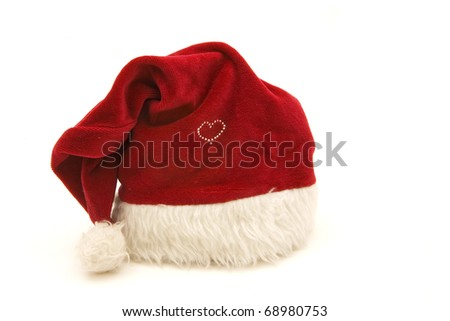 A red Santa Clause hat with a heart made of rhine stones isolated on white. - stock photo