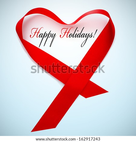 a red satin ribbon forming a heart and the sentence happy holidays - stock photo