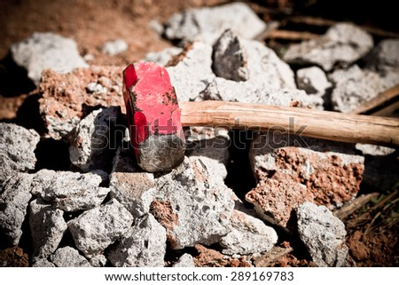 A red sledge hammer old and rusty  - stock photo