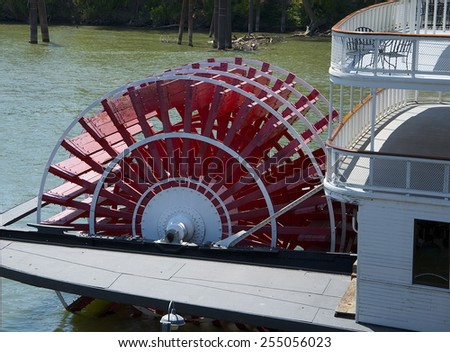 A Red Stern Wheeler Wheel  - stock photo