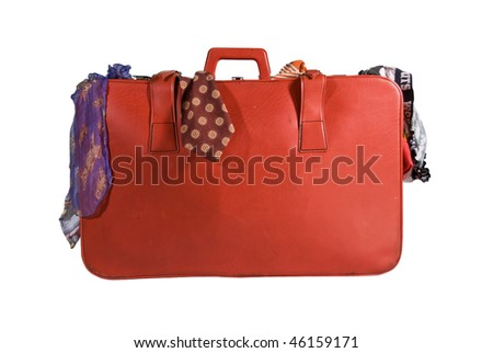 A red suitcase filled with colorful clothes isolated on white - stock photo