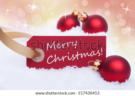 A Red Tag with a White Merry Christmas on It as Christmas Background - stock photo