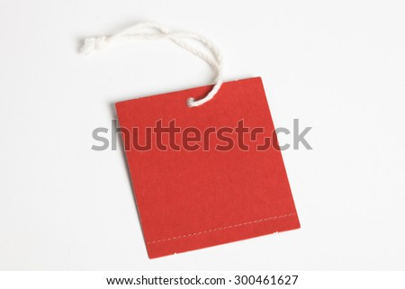 a red tag with white background - stock photo