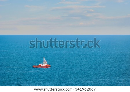 A Red Tugboat in the Black Sea - stock photo