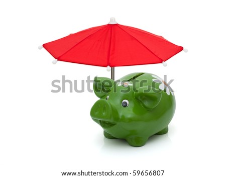 A red umbrella covering a piggy bank isolated on a white background, Protecting your money - stock photo