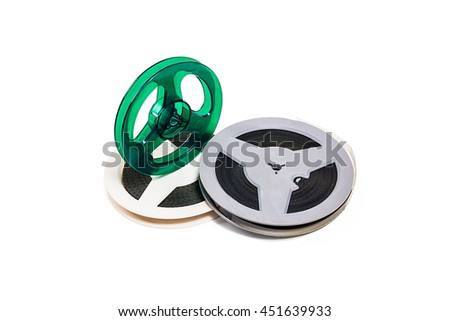 A reel of motion picture film on a white background. With clipping path. Old film strip isolated on white background. - stock photo