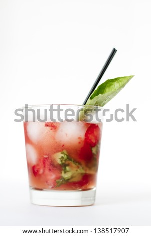 A refreshing strawberry, basil cocktail with a basil garnish. - stock photo