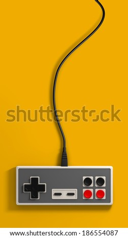 A regular vintage rectangular gaming controller with red and black buttons on an isolated yellow studio background - stock photo