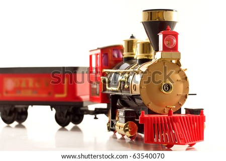 A remote control train composed over white. - stock photo