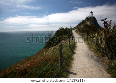 A remote lighthouse in a spectacular location on the eastern coast of South island New Zealand - stock photo