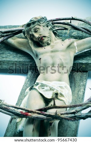 a representation of Jesus Christ in the Holy Cross and the crown of thorns - stock photo