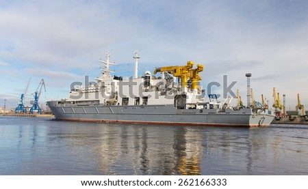 a rescue ship is moving in the port - stock photo