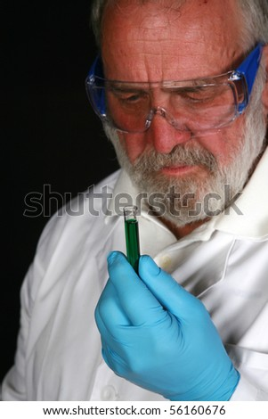 a research scientist or medical scientist conducts experiments with his lab equipment - stock photo