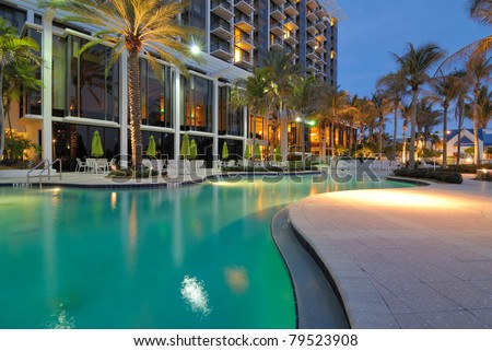 A resort swimming pool at twilight - stock photo