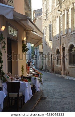 A restaraunt in Antibes. Cote d'Azur. Beautiful background. Artistic photo notes while traveling through Europe - stock photo