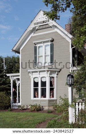 A restored 19th century Victorian gingerbread style house - stock photo