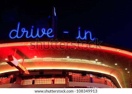 A retro diner all lit up at night with bright neon signage - stock photo