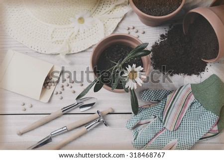 A retro instagram style shot of a gardening still life. Overhead view in horizontal format. - stock photo