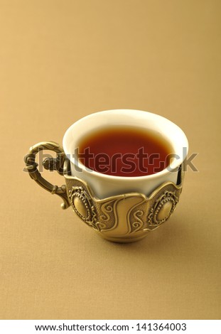 A retro islamic tea cup - stock photo