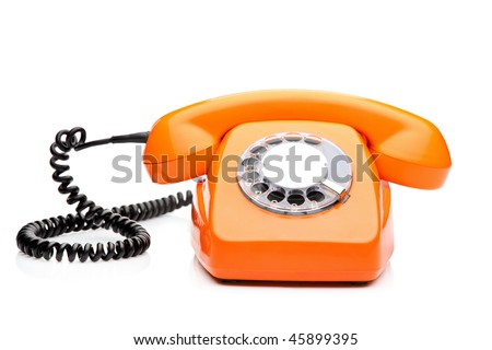A retro orange phone isolated on white background - stock photo