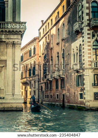 A Retro Style Photo Of Venice Italy With A Gondola In The Grand Canal - stock photo
