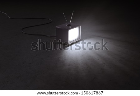 A retro TV set in an empty, dark interior - stock photo