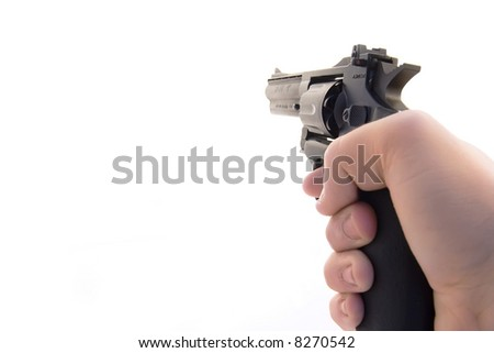 A revolver being aimed to fire - stock photo