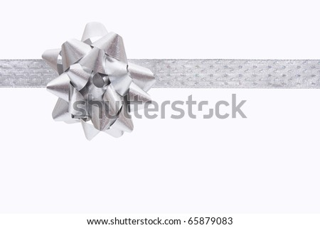 A ribbon and bow on a white background, christmas present - stock photo